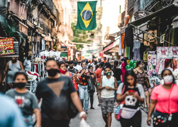 Pedestrians wearing protective masks walk on Alfandega Street in Rio de Janeiro, Brazil, on Thursday, July 23, 2020. Brazil registered 67,860 new cases on Wednesday, more than 20% above the previous record for daily infections. Photographer: Andre Coelho/Bloomberg